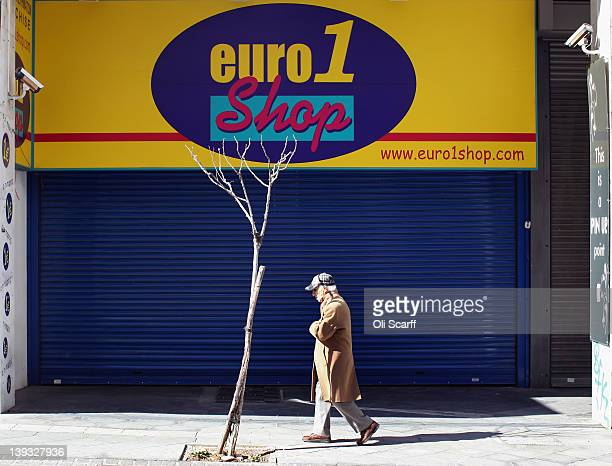 A man walks past a discount retailer of general merchandise at singleprice point of one euro on February 19 2012 in Athens Greece Following a meeting...