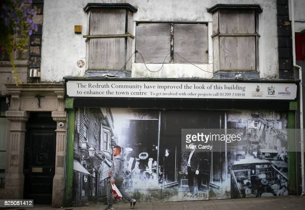 A man walks past a empty shop in Redruth on July 24 2017 in Cornwall England Figures released by Eurostat in 2014 named the British county of...