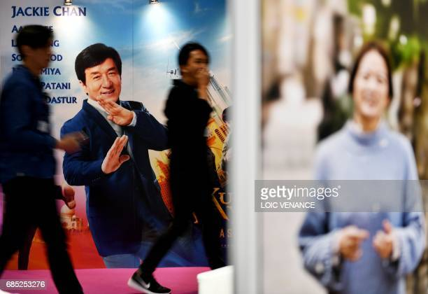 A man walks past a film poster at the international Film Market in the Festival's Palace on May 19 2017 during the 70th edition of the Cannes Film...