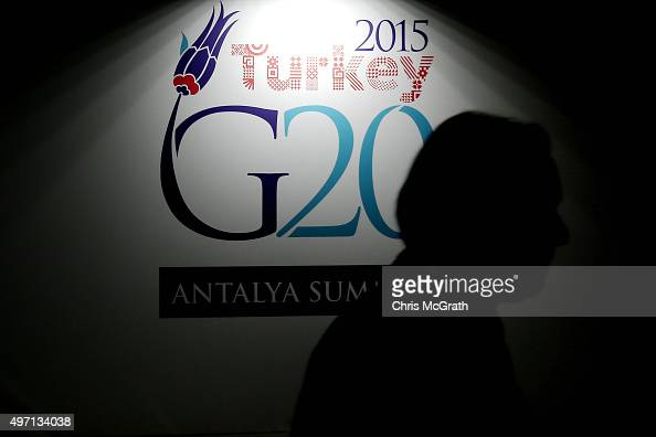 A man walks past a G20 Summit sign ahead of the start of the G20 Turkey Leaders Summit on November 14 2015 in Antalya Turkey World leaders delegates...