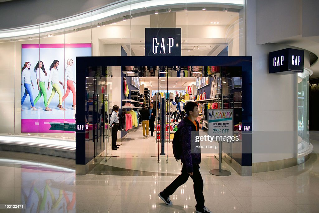 A man walks past a Gap Inc. store at Hysan Development Co.'s Hysan Place mall in the Causeway Bay district of Hong Kong, China, on Monday, March 4, 2013. Hysan is scheduled to release earnings on March 6. Photographer: Lam Yik Fei/Bloomberg via Getty Images