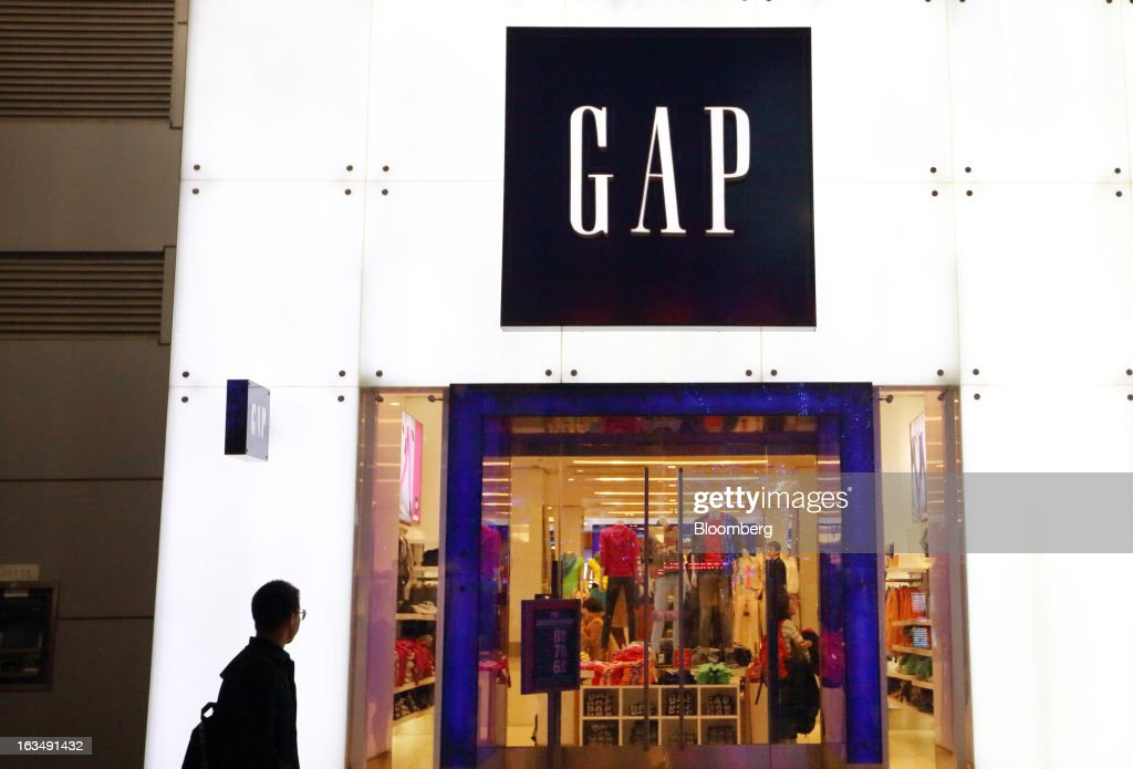 A man walks past a Gap Inc. store in the Wangfujing shopping district of Beijing, China, on Sunday, March 10, 2013. China's industrial output had the weakest start to a year since 2009 and lending and retail sales growth slowed, toughening challenges for a new leadership that wants to narrow the gap between rich and poor. Photographer: Tomohiro Ohsumi/Bloomberg via Getty Images