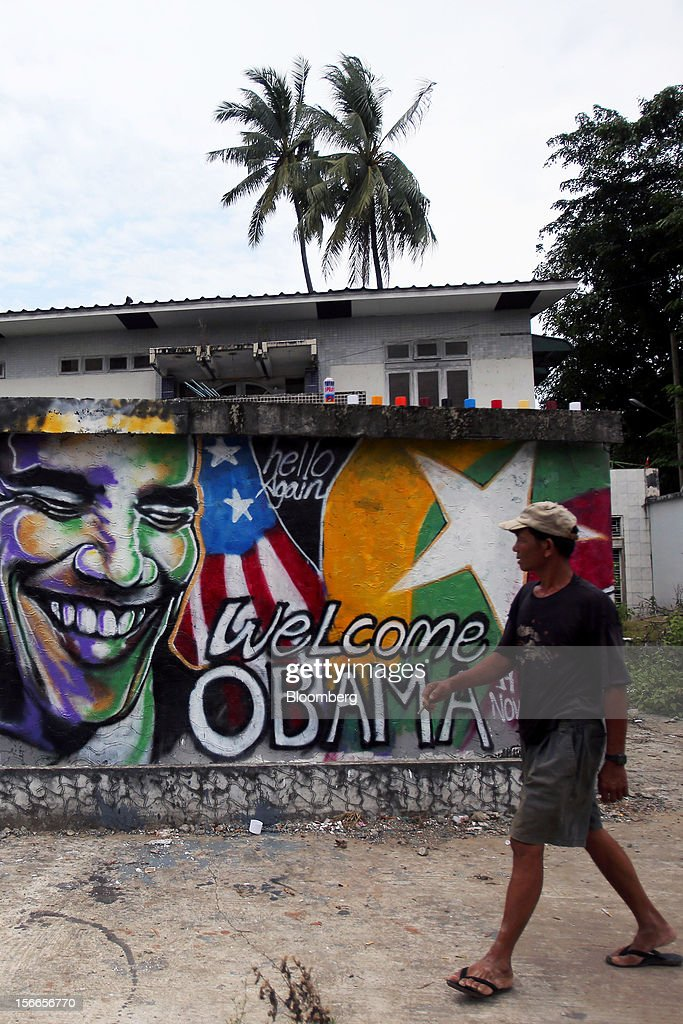 A man walks past a graffiti by Burmese artist Arker Kyaw welcoming U.S. President <a gi-track='captionPersonalityLinkClicked' href=/galleries/search?phrase=Barack+Obama&family=editorial&specificpeople=203260 ng-click='$event.stopPropagation()'>Barack Obama</a> to Myanmar on a wall in Yangon, Myanmar, on Sunday, Nov. 18, 2012. President <a gi-track='captionPersonalityLinkClicked' href=/galleries/search?phrase=Barack+Obama&family=editorial&specificpeople=203260 ng-click='$event.stopPropagation()'>Barack Obama</a> will become the first sitting U.S. president to visit Myanmar when he travels to Yangon on Nov. 19 to meet President Thein Sein and Aung San Suu Kyi, the opposition leader who spent more than 15 years under house arrest before the country shifted to democracy after decades of military rule. Photographer: Dario Pignatelli/Bloomberg via Getty Images
