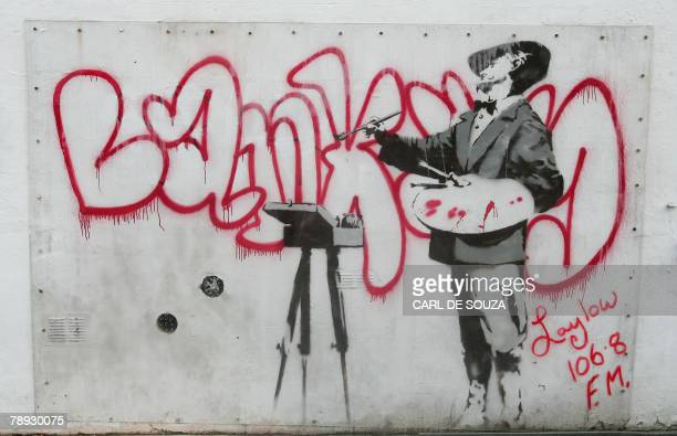 A man walks past a graffiti mural by British artist Banksy spraypainted on a wall on Portobello road in London 14 January 2008 The wall has been put...