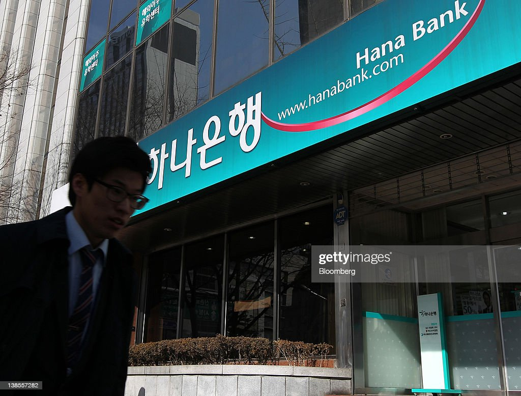 A man walks past a Hana Bank branch in Seoul, South Korea, on Thursday, Feb. 9, 2012. Hana Financial Group Inc. completed its 4.4 trillion won ($3.9 billion) purchase of Korea Exchange Bank from Lone Star Funds and Export Import Bank of Korea, allowing Hana to narrow a gap with rivals and the U.S. fund to exit the investment after eight years. Photographer: SeongJoon Cho/Bloomberg via Getty Images