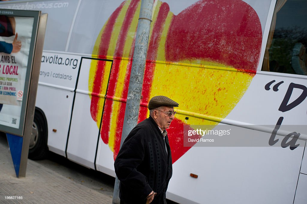 A man walks past a heart composed of a Spanish and a Catalan flag painted on the 'Civic Movement of Spain and Catalans' bus on November 22, 2012 in Barcelona, Spain. This civic movement defends the unity of Spain and asking for voting any Anti-separatist Political Party. Over 5 million Catalans will be voting in Parliamentary elections on November 25, with opinion polls showing majority support for pro-independence parties.