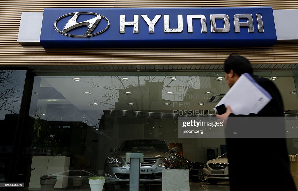 A man walks past a Hyundai Motor Co. dealership in Seoul, South Korea, on Tuesday, Jan. 22, 2013. Hyundai Motor Co. is scheduled to release fourth-quarter earnings on Jan. 24. Photographer: SeongJoon Cho/Bloomberg via Getty Images