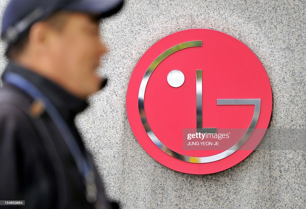A man walks past a logo of LG in front of the headquarters of LG Electronics in Seoul on October 24, 2012. South Korea's LG Electronics reported a third quarter swing back to profit compared to a huge loss a year ago, after its mobile phone business moved back into the black.