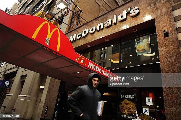 A man walks past a McDonald's in lower Manhattan on February 9 2015 in New York City McDonald's Corporation has said sales in January fell a...