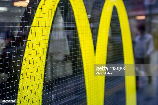 A man walks past a McDonalds restaurant on April 17 in Tokyo Japan McDonald's Holdings Co announced on April 16 2015 that it expects to post a 38...