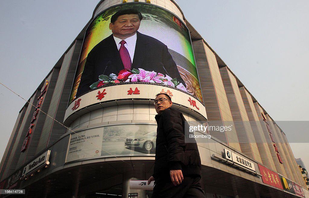 A man walks past a monitor broadcasting a news conference by Xi Jinping, general secretary of the Communist Party of China, outside a subway station in Beijing, China, on Thursday, Nov. 15, 2012. Xi replaced Hu Jintao as head of the Chinese Communist Party and the nation's military, ushering in the fifth generation of leaders who are set to run the world's second-biggest economy over the next decade. Photographer: Tomohiro Ohsumi/Bloomberg via Getty Images