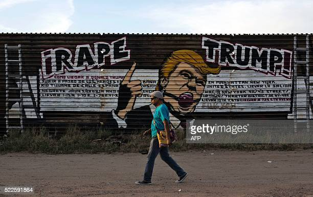 A man walks past a mural depicting US presidential candidate Donald Trump on the USMexico border fence at the Libertad neighborhood in Tijuana...
