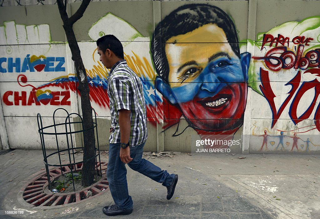 A man walks past a mural of Venezuelan President Hugo Chavez in Caracas on December 31, 2012. Vice President Nicolas Maduro reported on national radio and television from Havana that President Chavez suffered further complications from respiratory infection that arose after undergoing surgery on December 11.