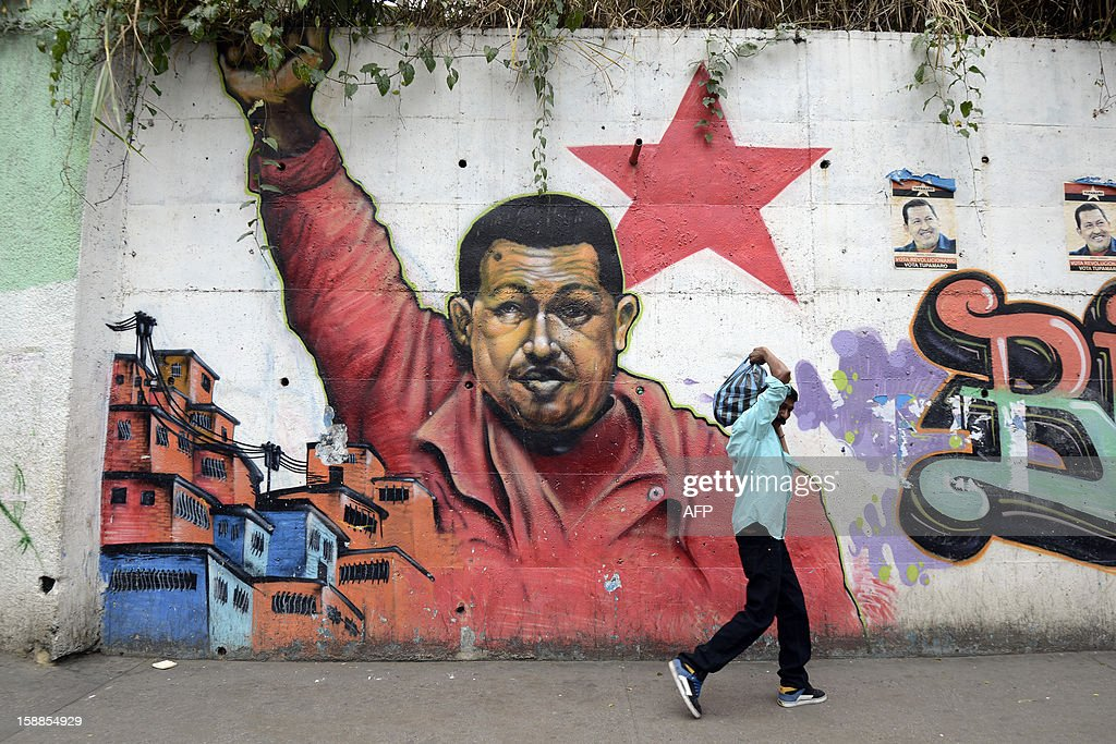 A man walks past a mural of Venezuelan President Hugo Chavez in Caracas were the streets are practically deserted on January 1, 2013. Somber Venezuelans began 2013 fretting over their ubiquitous and garrulous leader Hugo Chavez, wondering what the future holds as the president wages a tough battle with cancer in a Havana hospital. New Year's Eve revelry was tempered, and official acts -- two open air concerts -- were canceled outright out of respect for the ex-paratrooper who has dominated this oil-rich country so thoroughly since taking power in 1999. Chavez underwent his fourth cancer-related surgery three weeks ago in Havana and has been bed-ridden ever since. Information on his condition is scant, with the government admitting only to 'complications' in his recovery.