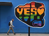 A man walks past a mural promoting the Yes campaign in favour of samesex marriage on May 22 2015 in Dublin Ireland Voters in the Republic of Ireland...