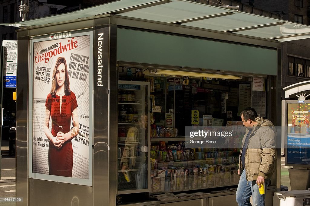 A man walks past a newstand with a billboard promoting CBS's 'The Good Wife' as seen in this 2009 New York, NY, early afternoon cityscape photo.