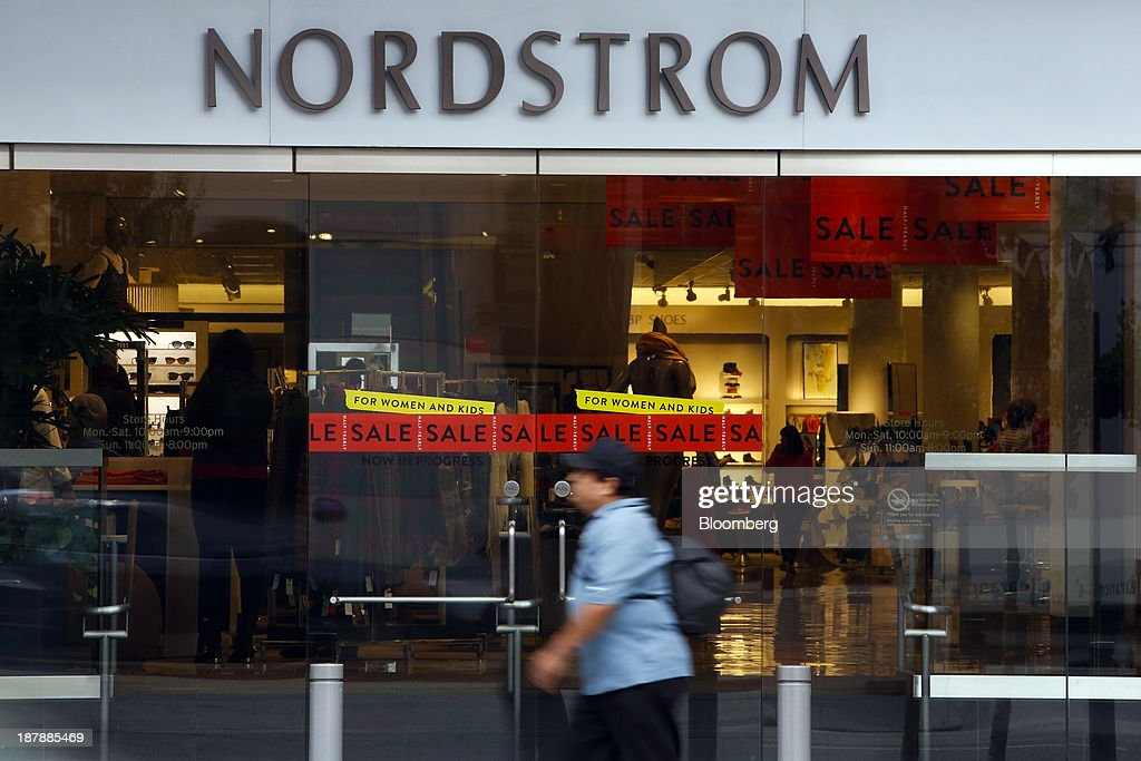 A man walks past a Nordstrom Inc. department store in Santa Monica, California, U.S., on Tuesday, Nov. 12, 2013. Nordstrom Inc. is scheduled to release earnings figures on Nov. 14.m Photographer: Patrick T. Fallon/Bloomberg via Getty Images