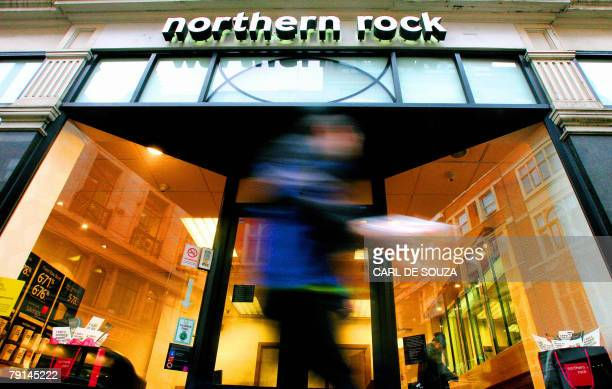 A man walks past a Northern Rock bank branch London 21 January 2008 British Chancellor of the Exchequer Alistair Darling has outlined plans to...