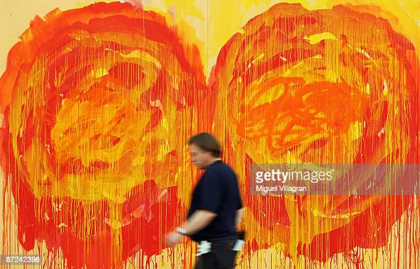 A man walks past a painting depicting roses by artist Cy Twombly at the museum Brandhorst on May 15 2009 in Munich The museum which shows works from...