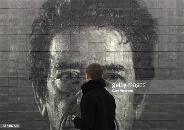 A man walks past a portrait of musician Lou Reed by artist Chuck Close at the 86th Street station on the Second Avenue subway line on January 3 2017...