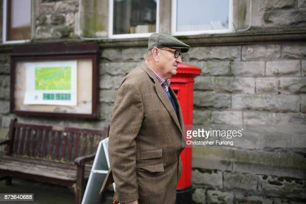 A man walks past a post box in the Yorkshire village of Hawes which is trying to make itself the most selfsufficient place in Britain on November 13...