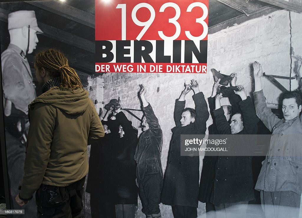 A man walks past a poster advertising the exhibition 'Berlin 1933 – The Road to Dictatorship' at the Topography of Terror museum in Berlin January 29, 2013. The exhibition highlights key points up until the Summer of 1933. At the same time, it displays victims' biographies within the early stages of NS-Terror, in the months after 30th January 1933. The exhibition coincides with the 80th anniversary of Adolf Hitler's accession to power January 30, 1933.