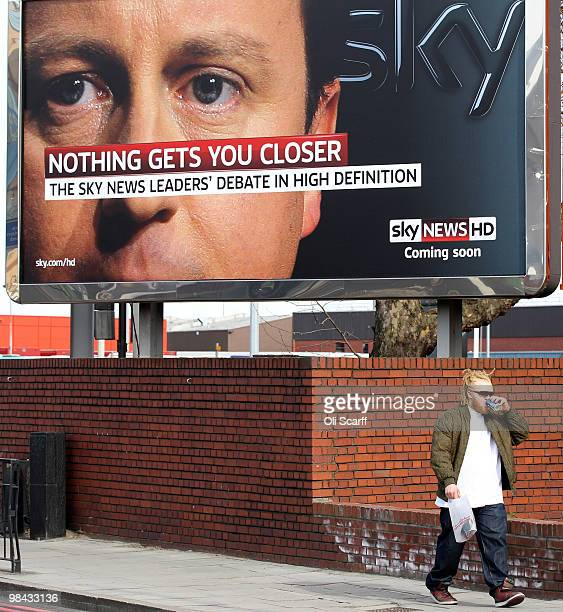 A man walks past a poster advertising the forthcoming televised political leaders' debate on April 13 2010 in London England The leaders of the three...