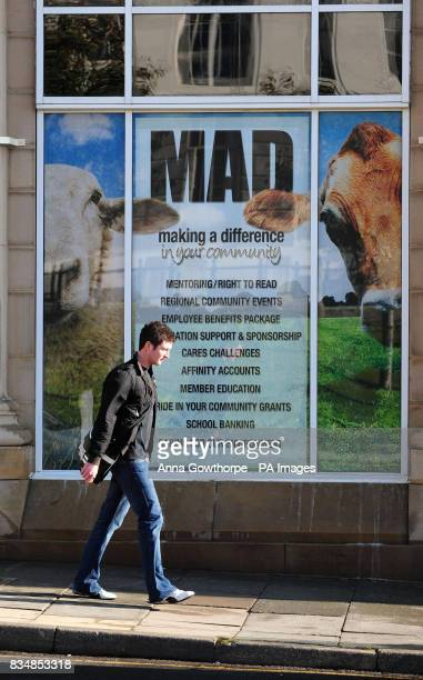 A man walks past a poster on display in the window of the Barnsley Building Society Permanent Building in Regent Street Barnsley
