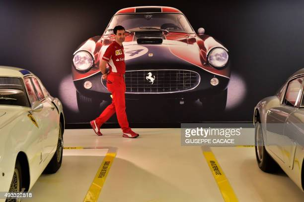 A man walks past a poster showing a Ferrari at the Ferrari Museum on October 18 2015 in Maranello Fiat Chrysler Automobiles is planning a US stock...