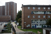 A man walks past a residential tower block in an area of Southwark with a high concentration of social housing on August 28 2014 in London England A...