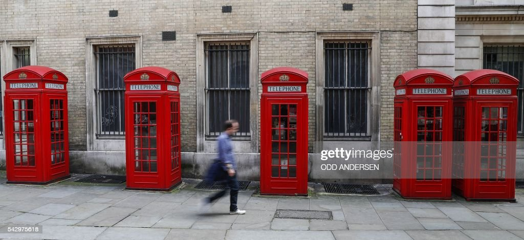 A man walks past a row of iconic red telephone boxes in central London on June 25, 2016, after the announcement that the UK had voted on June 23 to leave the European Union in a national referendum. The result of Britain's June 23 referendum vote to leave the European Union (EU) has pitted parents against children, cities against rural areas, north against south and university graduates against those with fewer qualifications. London, Scotland and Northern Ireland voted to remain in the EU but Wales and large swathes of England, particularly former industrial hubs in the north with many disaffected workers, backed a Brexit. / AFP / Odd ANDERSEN