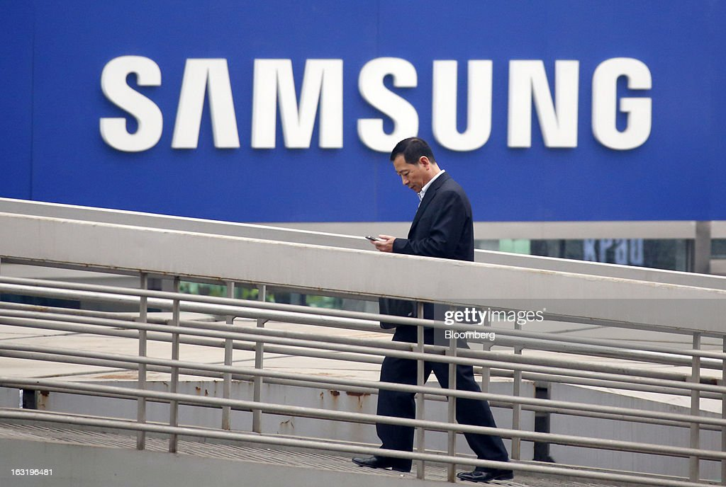 A man walks past a Samsung Electronics Co. shop in Beijing, China, on Wednesday, March 6, 2013. China maintained its economic-growth target at 7.5 percent for 2013 while setting a lower inflation goal of 3.5 percent, setting up a challenge for new leaders to keep prices in check without harming expansion. Photographer: Tomohiro Ohsumi/Bloomberg via Getty Images