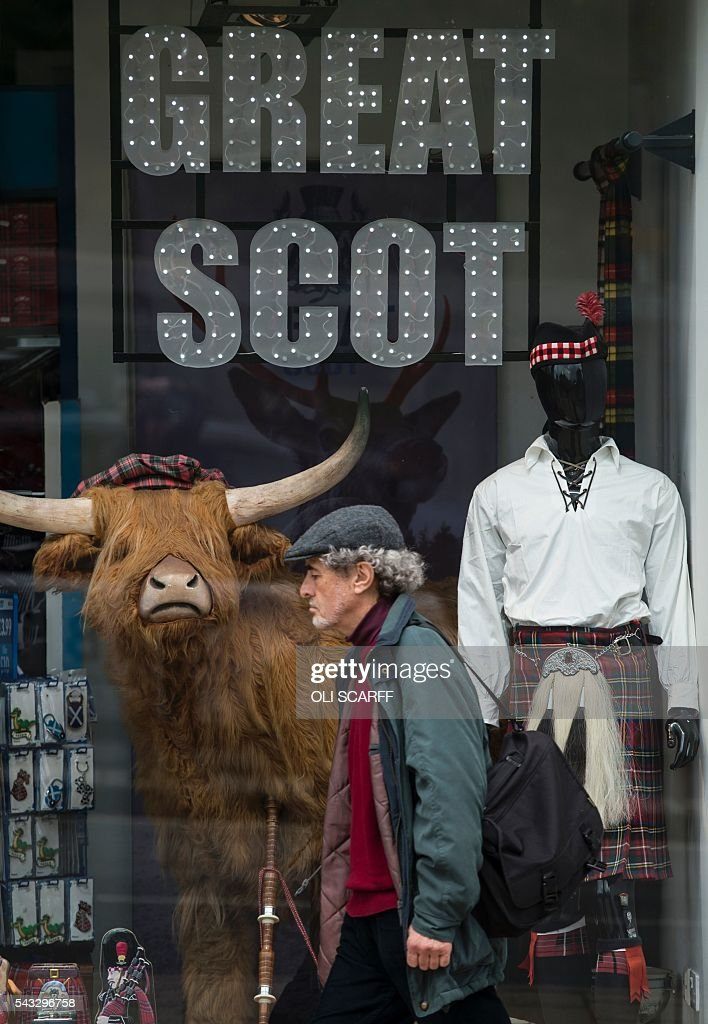 A man walks past a Scottish-themed gift shop in the city centre of Edinburgh, Scotland on June 27, 2016. Britain's historic decision to leave the 28-nation bloc has sent shockwaves through the political and economic fabric of the nation. It has also fuelled fears of a break-up of the United Kingdom with Scotland eyeing a new independence poll, and created turmoil in the opposition Labour party where leader Jeremy Corbyn is battling an all-out revolt. SCARFF