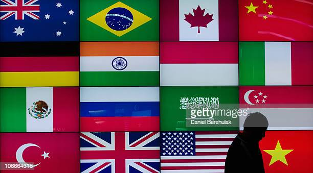 A man walks past a screen displaying flags of G20 countries inside of the COEX convention centre the venue of the 2010 G20 Summit on November 10 2010...