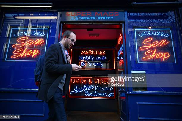 A man walks past a sex shop in Soho on January 16 2015 in London England A growing number of campaigners including Stephen Fry are pushing developers...