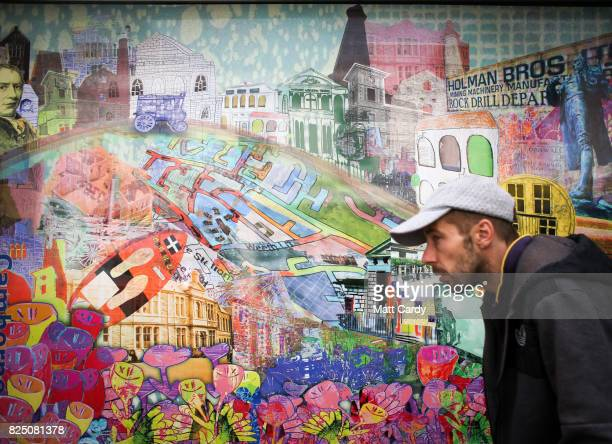 A man walks past a shop decorated with images of Camborne on July 24 2017 in Cornwall England Figures released by Eurostat in 2014 named the British...