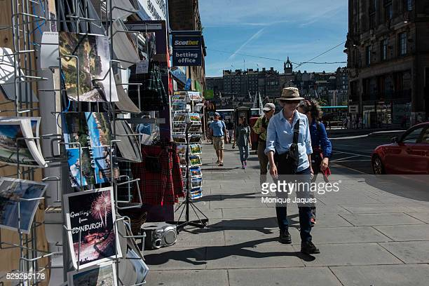 A man walks past a shop selling kilts and souvieners in downtown Edinburgh If the refrendum passes Scotland will rely heavily on tourism whiskey...