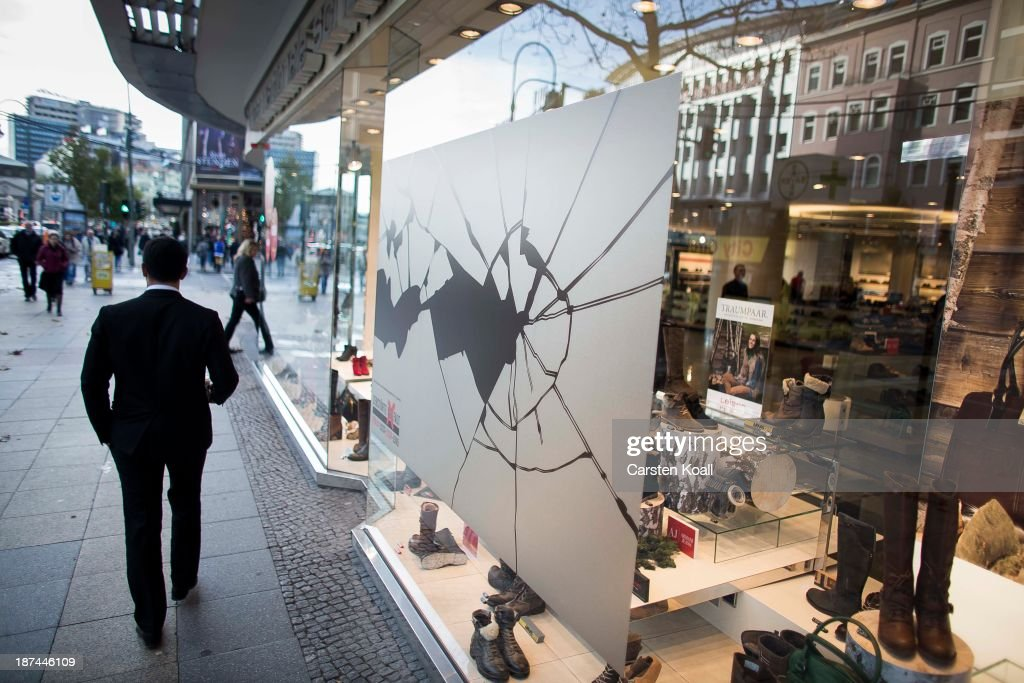 A man walks past a shop window made to look like it has been smashed to commemorate the 75th anniversary of the Kristallnacht pogroms on November 9, 2013 in Berlin, Germany. Events are taking place across the country to commemorate the day in 1938 when Nazi followers across Germany and Austria burned down synagogues, smashed Jewish-owned businesses, looted Jewish residences and killed several hundred Jews. Anti-semitism was a central component of Adolf Hitler's rise to power and won him wide-spread sympathy among ordinary Germans and Austrians.