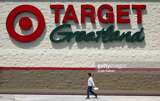 A man walks past a sign at a Target Greatland store May 15 2003 in San Bruno California Retailer Target Corp reported a slight increase in quarterly...
