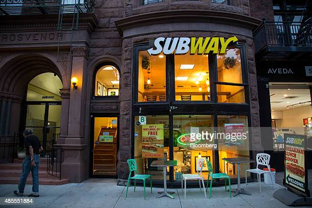 A man walks past a Subway Restaurants location in the Brooklyn borough of New York US on Thursday Aug 27 2015 After years of explosive growth turned...