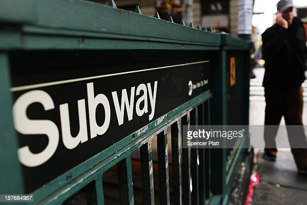 A man walks past a subway stop in Manhattan two days after a man was pushed to his death in front of a train on December 5 2012 in New York City The...