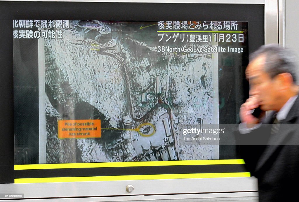 A man walks past a televsion broadcasting reporting the North Korea's nuclear test at an electronics store on February 12, 2013 in Tokyo, Japan. North Korea confirmed it had successfully carried out an underground nuclear test as a shallow earthquake with a magnitude of 4.9 was detected by several international monitoring agencies. South Korea and Japan both assembled an emergency meeting of their respective national security teams after the incident.