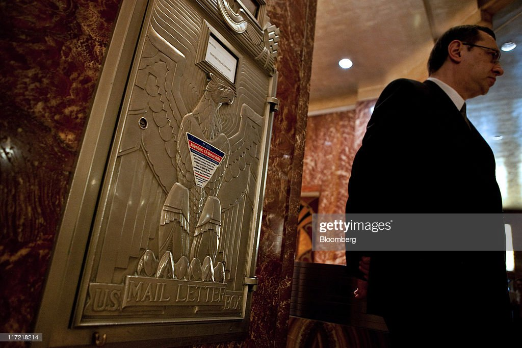 A man walks past a U. S. Postal Service mailbox in the lobby of the Chrysler building in New York, U.S., on Thursday, June 23, 2011. The U.S. Postal Service, facing insolvency without approval to delay a $5.5 billion payment for worker health benefits, will suspend contributions to an employee retirement account to save $800 million this year. Photographer: Timothy Fadek/Bloomberg via Getty Images