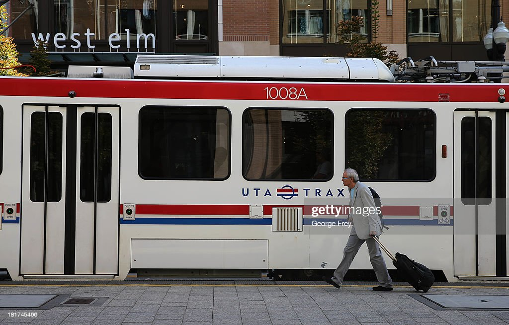 A man walks past a Utah Transit Authority Trax train at the City Creek Center shopping mall September 24, 2013 in Salt Lake City, Utah. Jack Harry Stiles was arrested on charges of treating terrorism after he informed mental health officials that he was planning on committing mass shootings at the City Creek Center Mall and other locations around Salt Lake City on September 25, 2013. Part of his alleged plan was to set off a bomb on a bus or train as it went under the City Creek sky bridge.