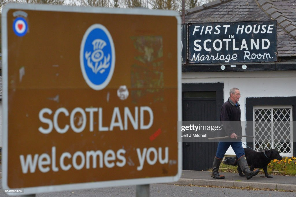 A man walks past a welcome to Scotland sign on October 22, 2012 in Gretna, Scotland. Last week Scottish First Minister Alex Salmond met with British Prime Minister David Cameron and agreed on details for a Scottish independence referendum to be held in the autumn of 2014 asking a single yes or no question on whether the country should become independent.