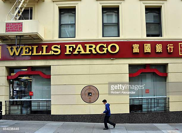 A man walks past a Wells Fargo Bank in San Francisco's Chinatown
