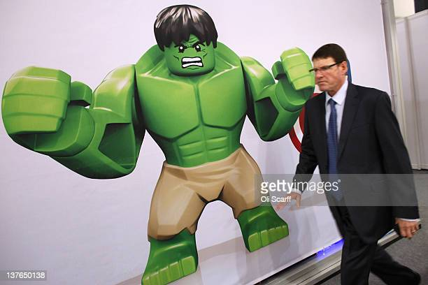 A man walks past an advertisement for a Lego 'Hulk' character at the 2012 London Toy Fair at Olympia Exhibition Centre on January 24 2012 in London...