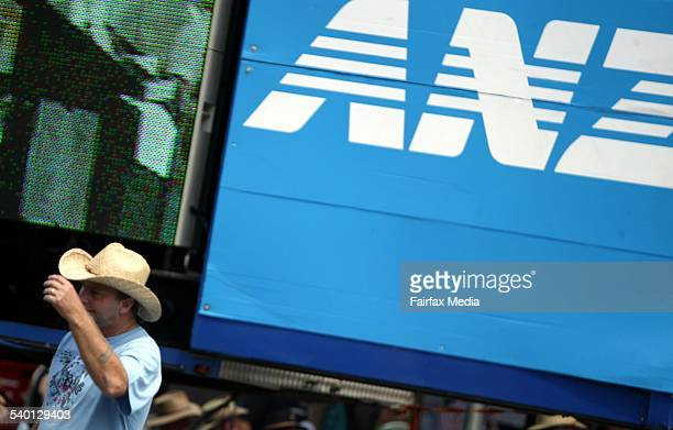 A man walks past an advertisement for ANZ Bank in Tamworth NSW 19 January 2005 AFR Picture by LOUIE DOUVIS