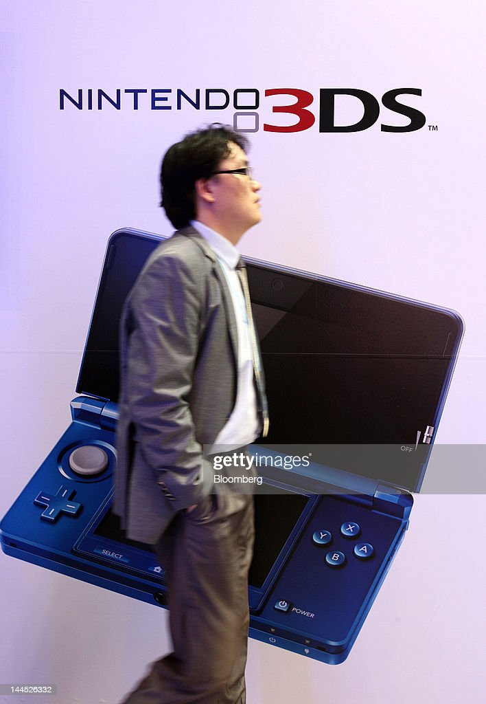A man walks past an advertisement for the Nintendo Co. 3DS handheld game console in the company's booth at the World IT Show 2012 in Seoul, South Korea, on Tuesday, May 15, 2012. The show will be held through May 18. Photographer: SeongJoon Cho/Bloomberg via Getty Images