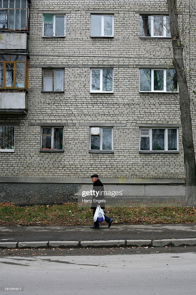 A man walks past an apartment block on November 3, 2011 in Yekaterinburg, Russia. Yekaterinburg is one of thirteen cities proposed as a host city for the 2018 FIFA World Cup in Russia.